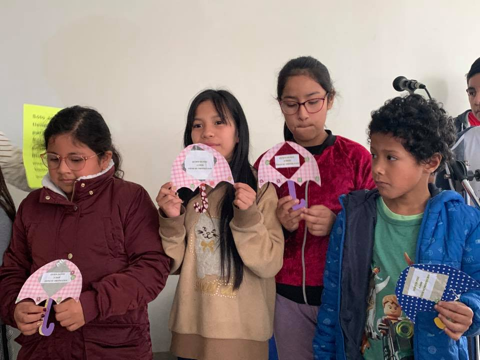 Children in Peru Sharing their Sunday School Crafts